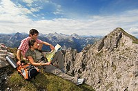Austria, Salzburger Land, couple on mountain top, portrait