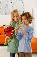 Girl 8_9 and boy 6_7, playing recorder