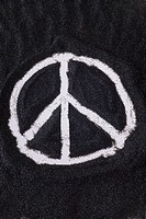 Peace symbol drawn in sand