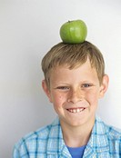 Boy 10_11 with apple on head,head and shoulders,portrait