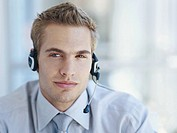 Businessman wearing headset, close_up