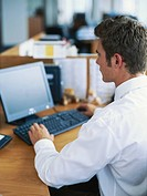 Businessman in office using computer, elevated view