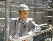 Business man in hard hat on construction site
