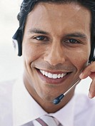 Businessman wearing headset, smiling, portrait, close_up