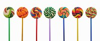 Multi-coloured lollipops in row against white background
