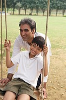 father with son on swing