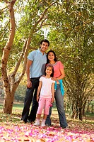 Young family in grove of trees