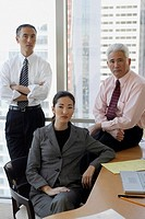 two businessmen, one businesswoman