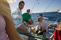 group of four friends on sailing boat