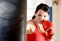 portrait of young woman doing boxing training
