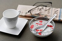 Heart with milk, news paper and cup