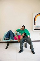 Couple waiting in laundromat