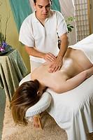 Masseur massaging client