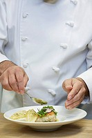 Male chef preparing food close_up
