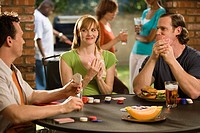 Friends playing poker outdoors