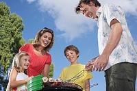 Family with two children 5_6 grilling in garden