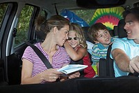 Family with two children 5_6 in car interior talking