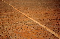 Car driving along desert road outback Australia