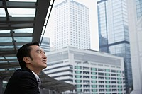 China Hong Kong business man looking at cityscape side view