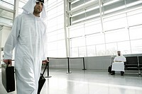 View of an Arab man waiting at an airport.