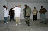 View of a group of rappers performing.