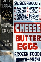 Psychic readings sign next to sign for sausage products, cheese, butter and eggs, Chicago  Illinois, USA