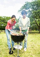 Young people barbecuing