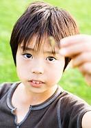 A boy grabbing a dragonfly