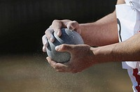 Athlete Holding Metal Ball