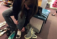 Teenager Trying on Shoes at a Shoe Sale
