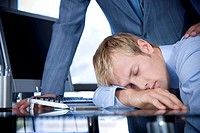 Businessman asleep at his desk