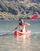 A woman canoeing on a lake