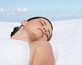 A woman sunbathing by a pool
