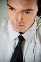 Portrait of a man using a call centre headset