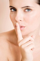 Woman putting her finger to her lips