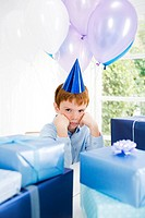 boy sulking at birthday party