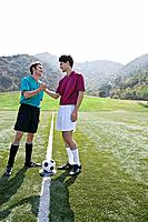 Opposing soccer players shaking hands