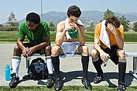 Defeated soccer team on bench