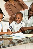 Smiling boy reading with family