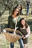 Mother and daughther with basket of olives