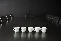 Coffee cups on a conference table