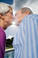 A senior couple kissing