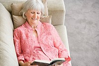 A senior woman reading a book