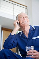 A senior man using a cell phone