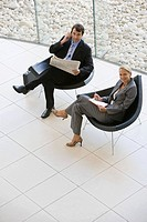 Two business colleagues in armchairs