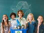 Children with a recycling bin