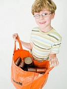 Boy with a recycling bag