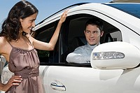Flirty couple and car (thumbnail)