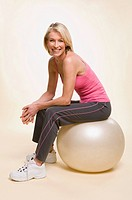 A woman sat on a gym ball