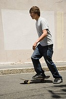 A teenage boy skateboarding